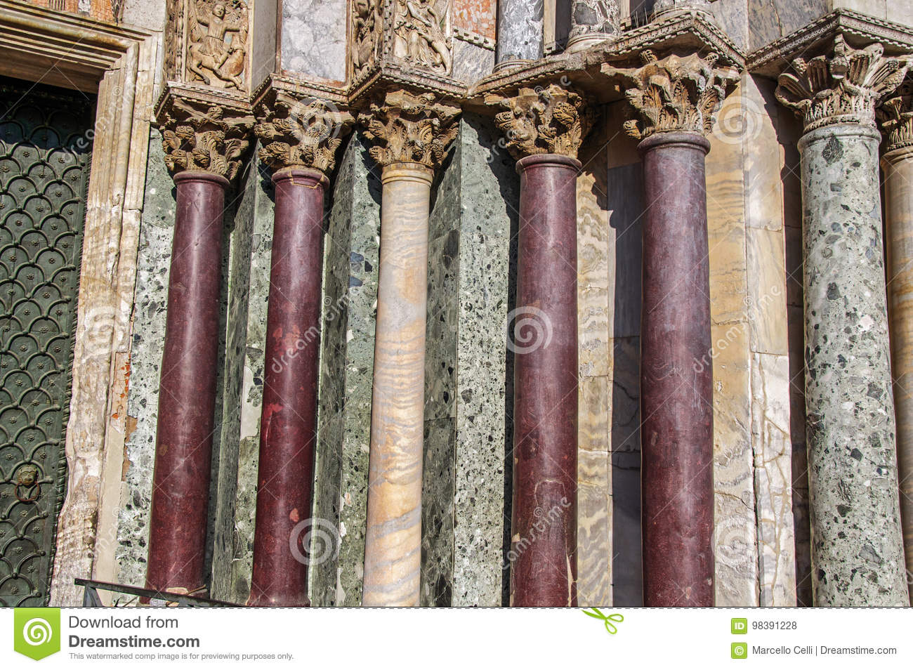 Close-up of columns and capitals made of various types of marble on the San Marco Basilica facade at Venice.