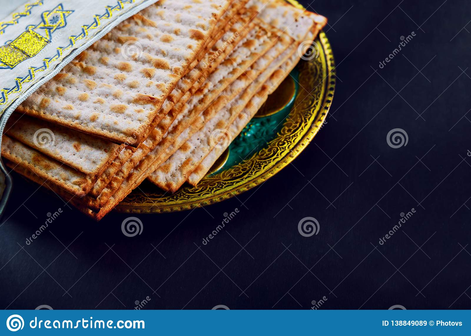 Close up of concept jewish holiday passover matzot and tallit the substitute for bread on the Jewish Passover holiday