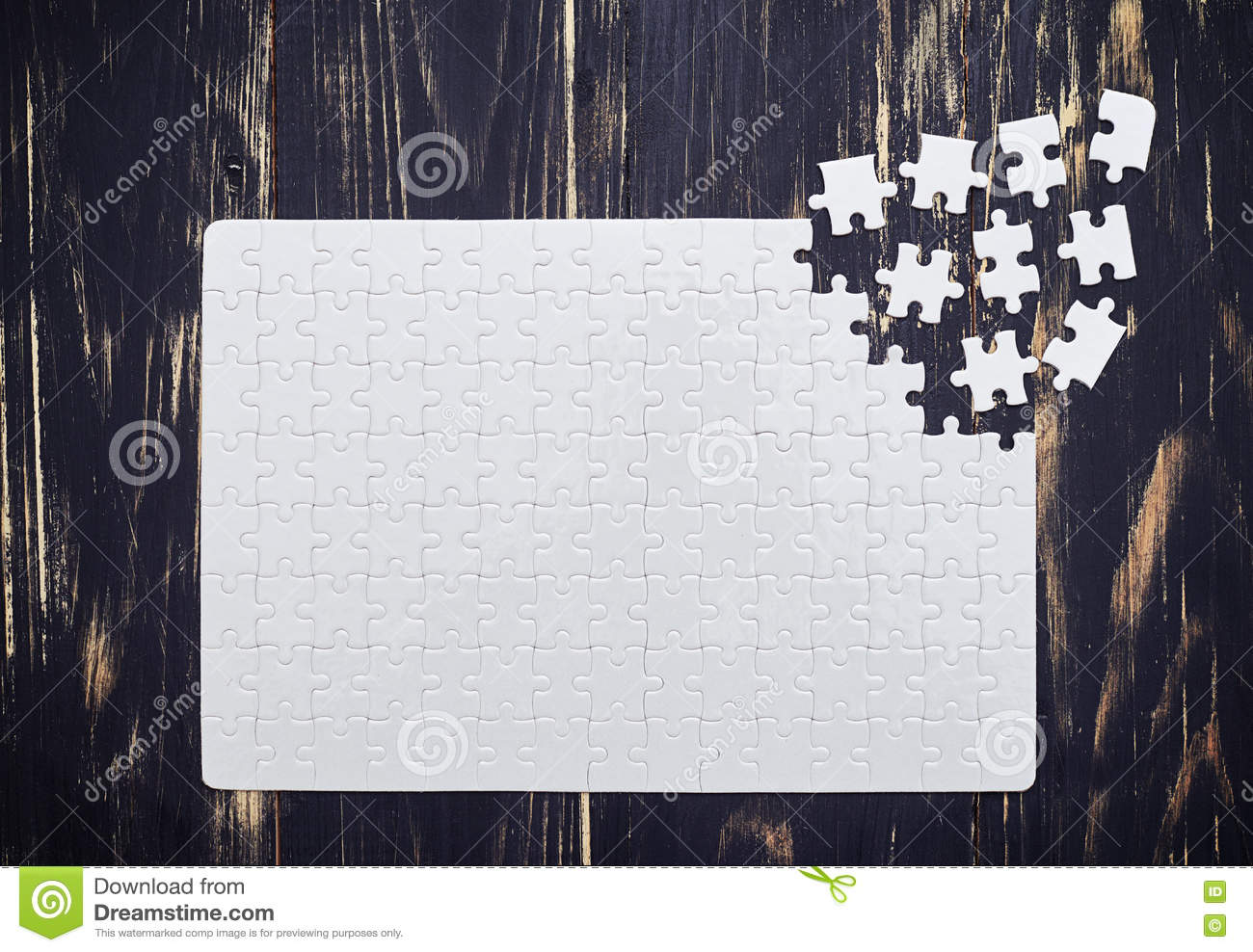 Close up of connecting puzzle with scattered pieces