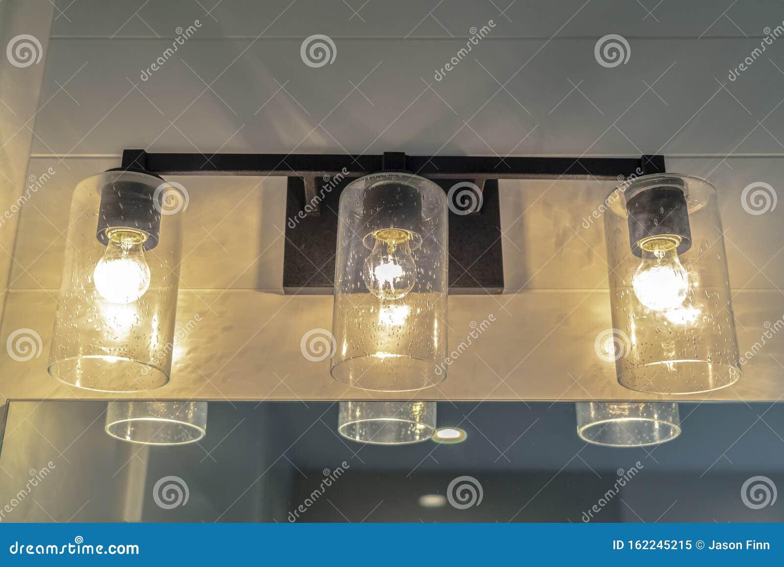 Close Up Of Contemporary Bathroom Mirror Lights Stock Image Image Of Illuminated White 162245215