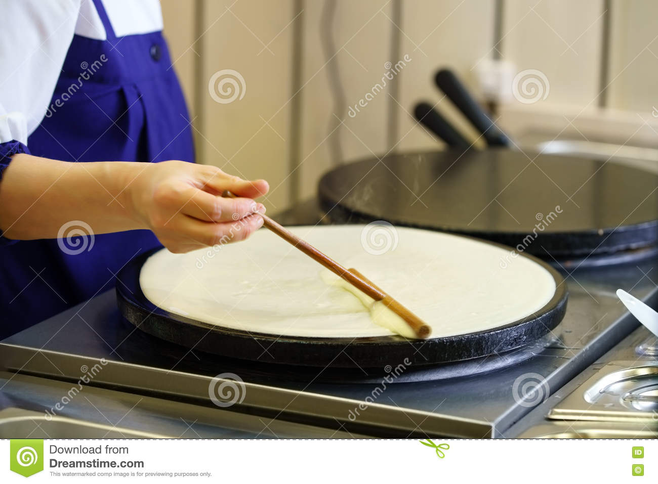 Close-up of cook frying crepe or pancake