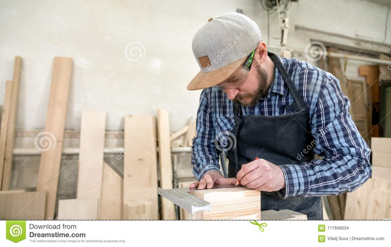 Experienced carpenter work with wooden