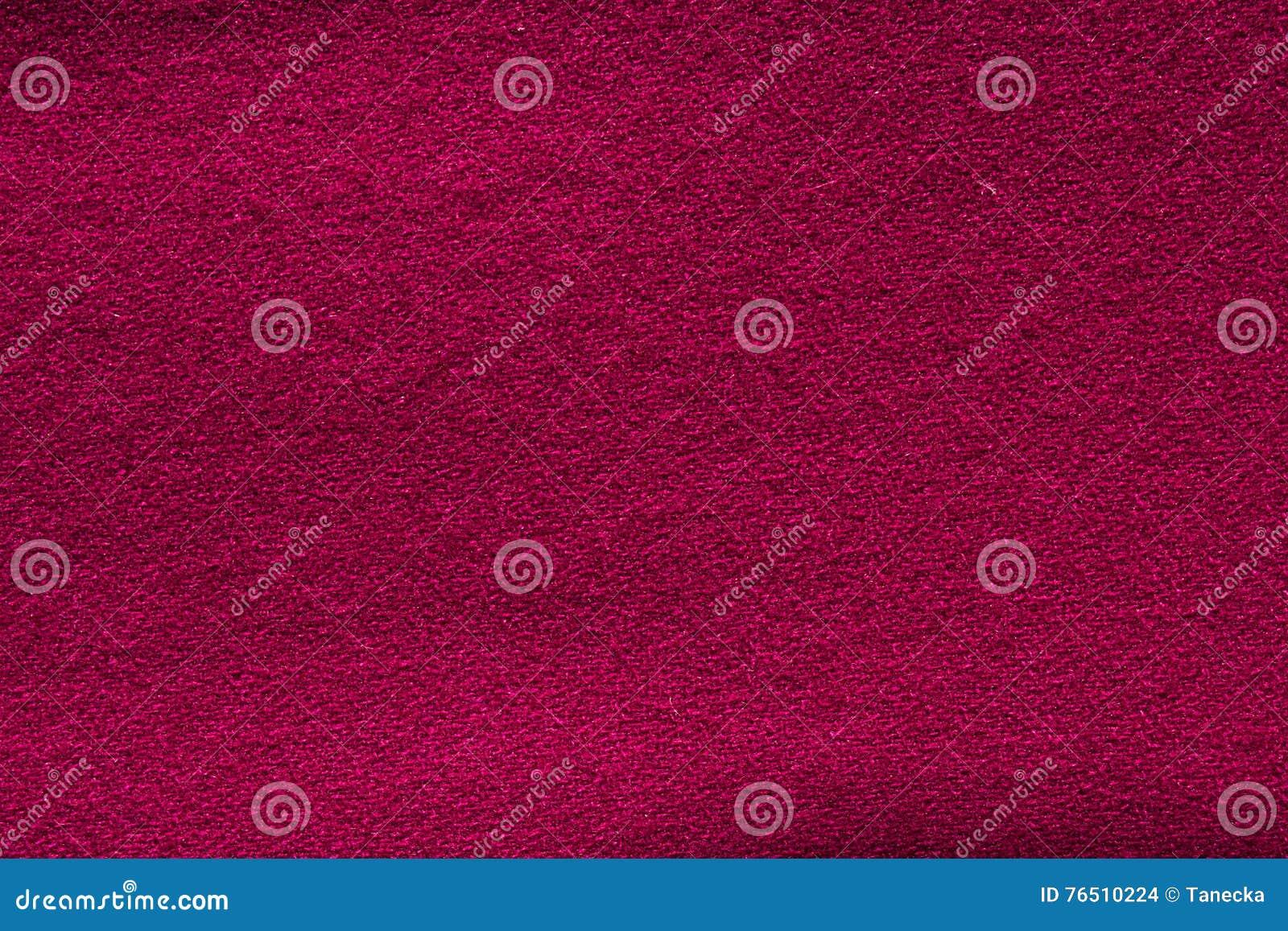 Close up crimson woollen knitted fabric texture. Loden background
