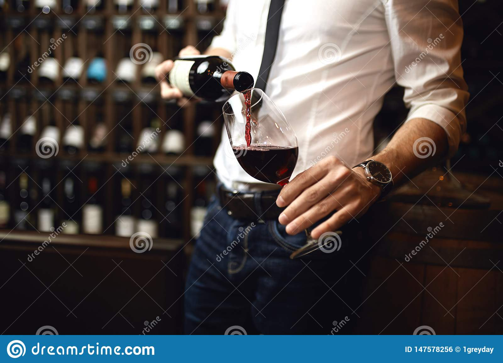 Focus on the bottle of red wine