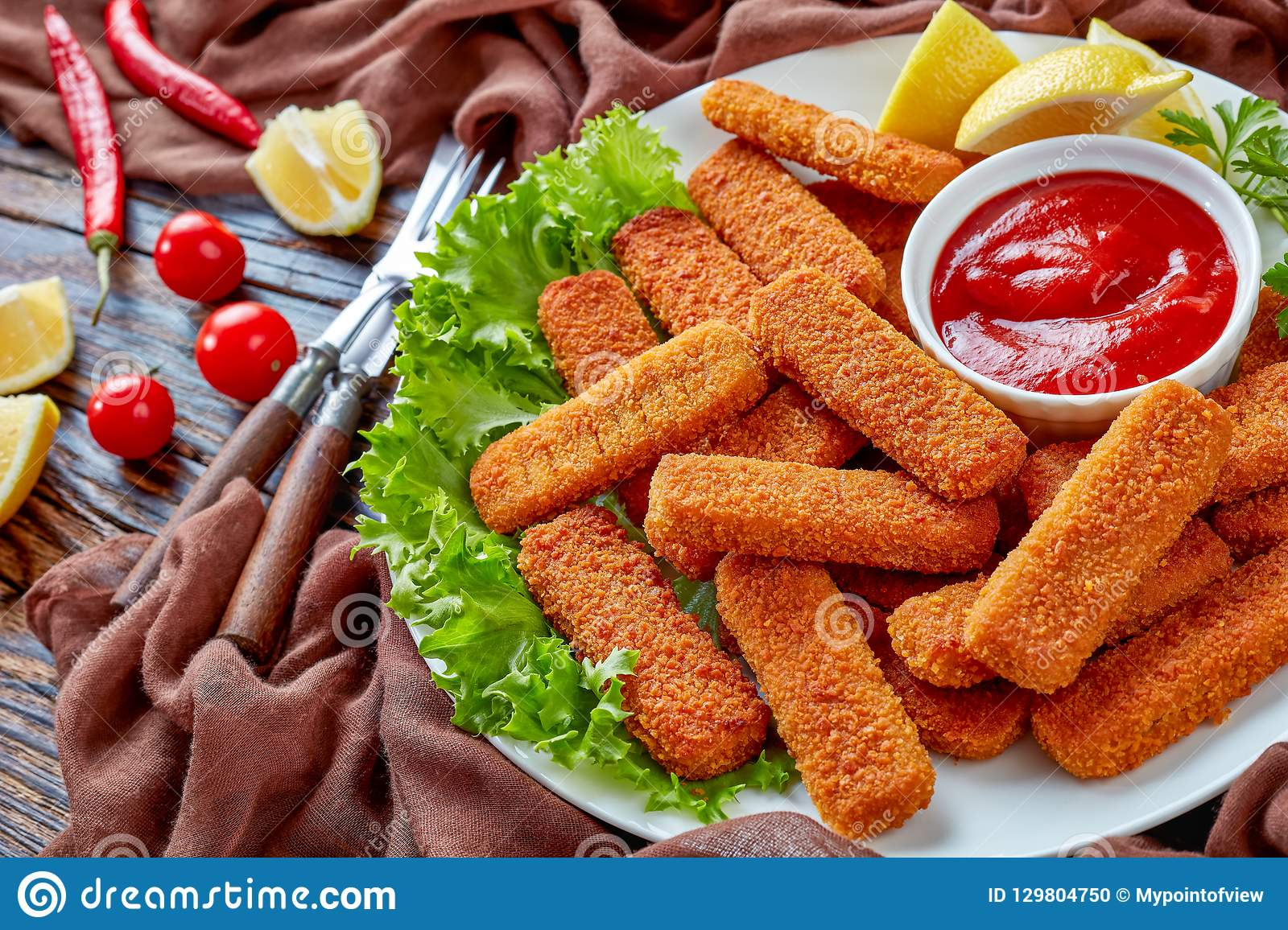 Close-up of crumbed fish sticks, top view