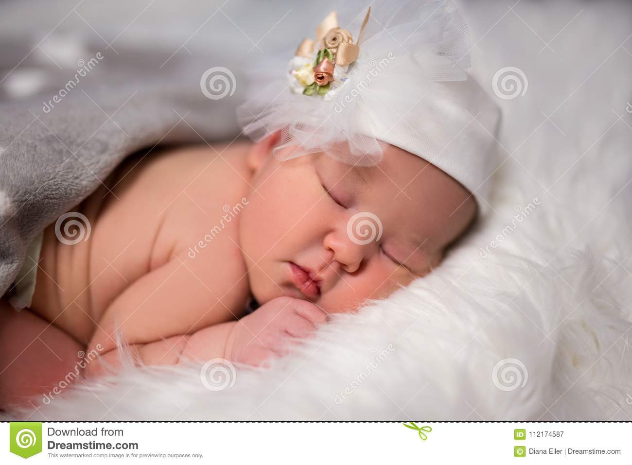 close up of cute sleeping baby in hat over white stock image - image