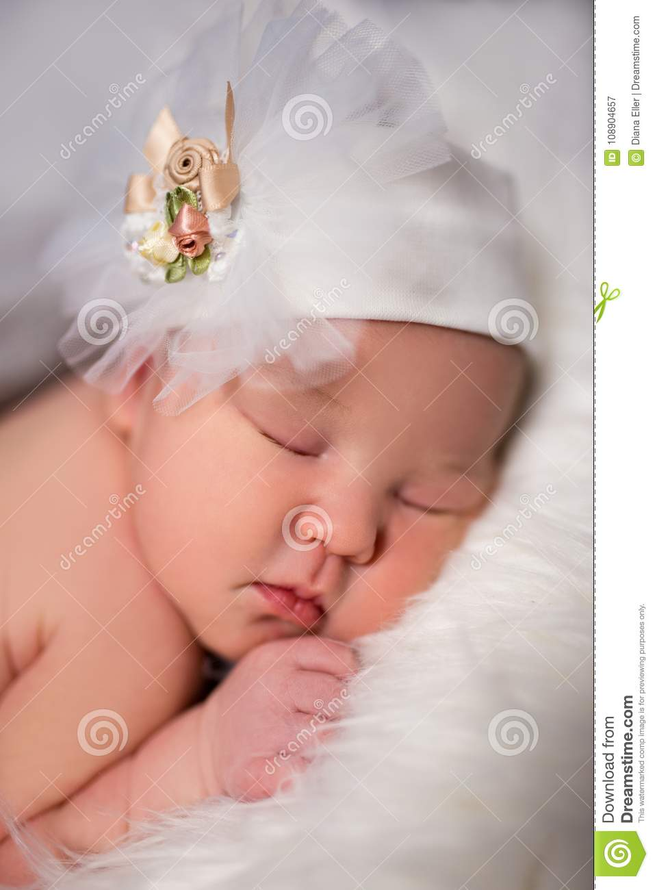 close up of cute sleeping baby in white hat stock image - image of