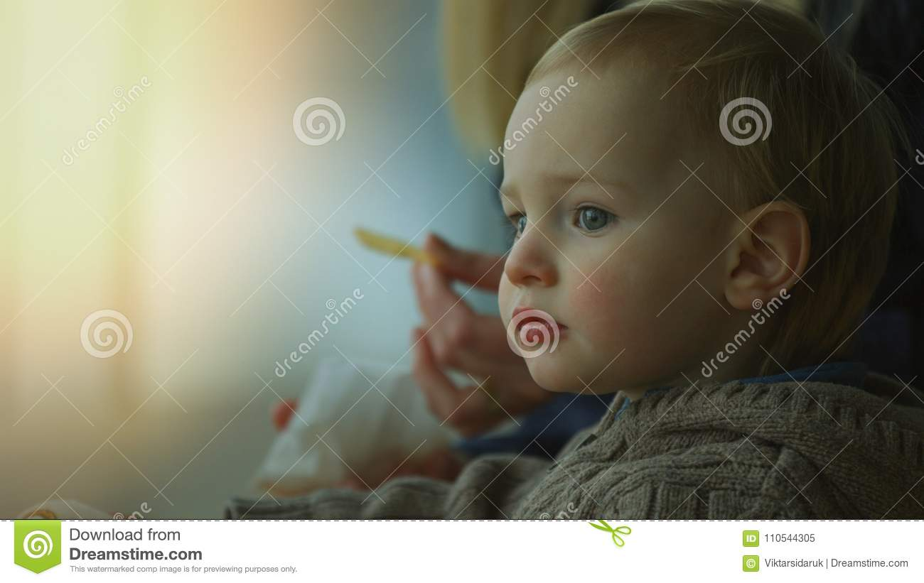 Close up of a cute small boy eating french fries
