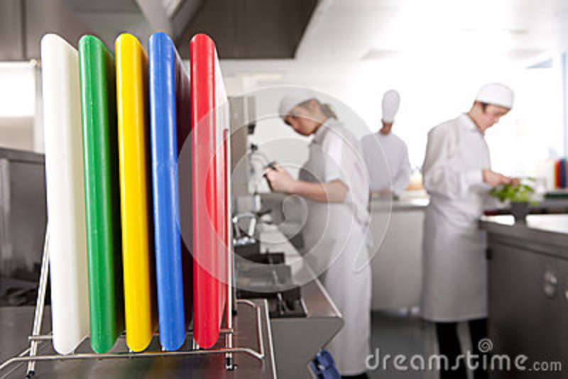 Close Up Of Cutting Boards In Commercial Kitchen Stock