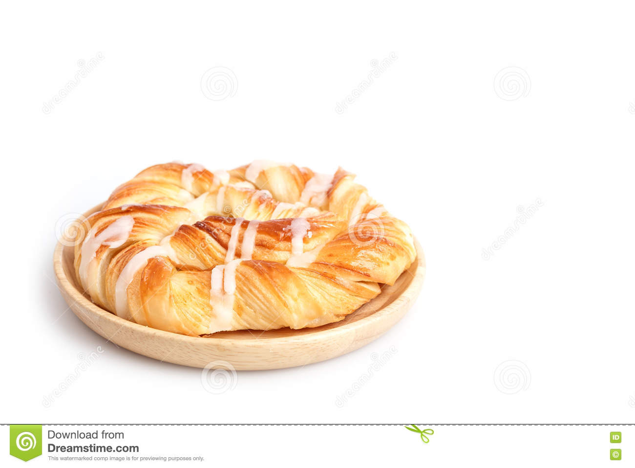 Close up Danish pastries on wooden dish on white