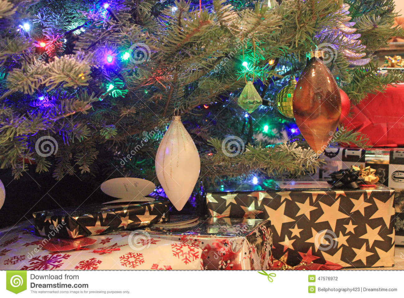 close up of a decorated christmas tree with presents