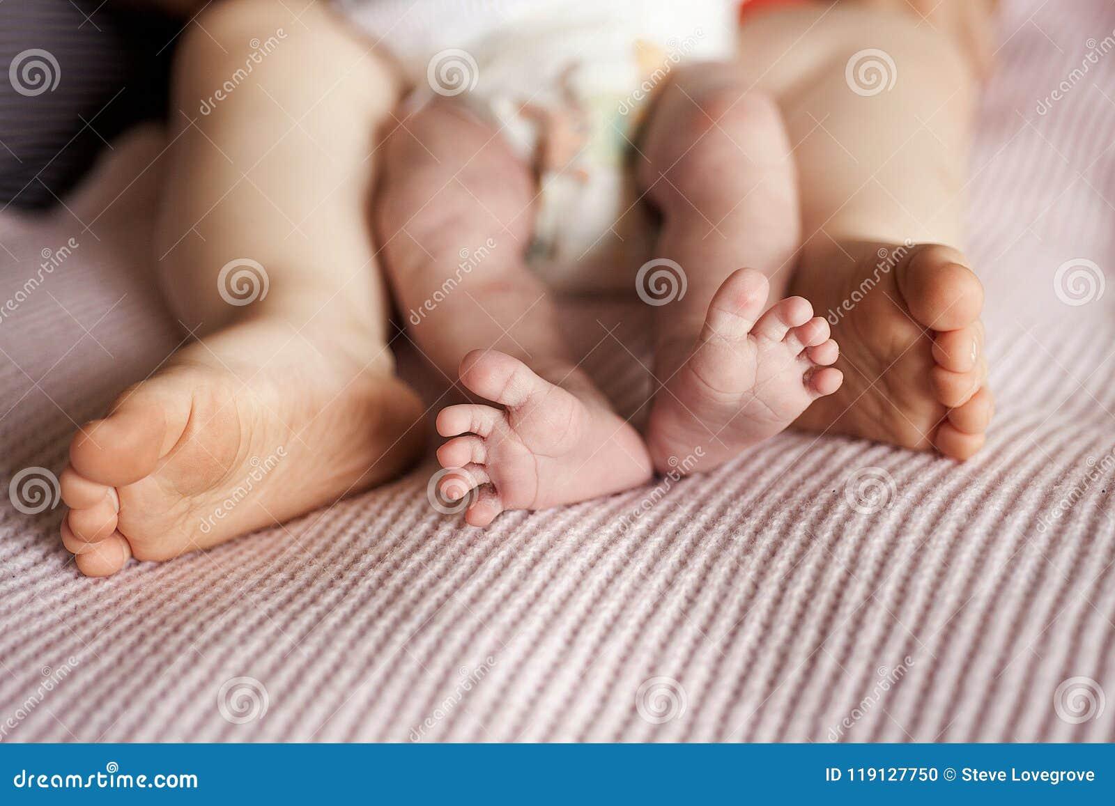 Close Up Detail Of Newborn Baby Boys Feet