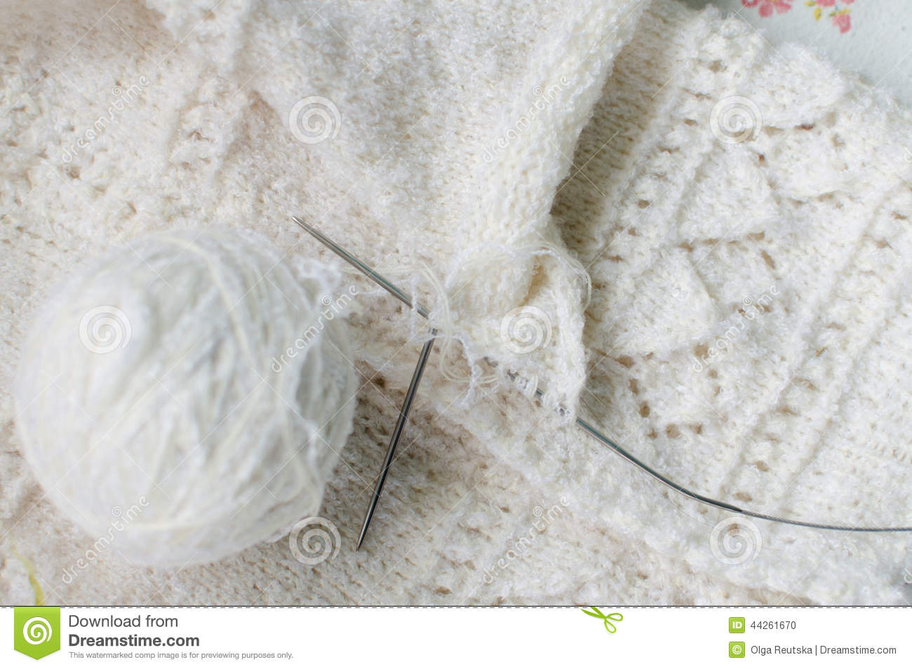 Close up detail of white wool woven handicraft knit baby for Space made of fabric