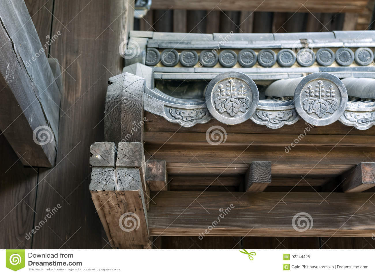 Close up details of Hanagawara or roof tile ornamentation with floral and plant designs in traditional Japanese architecture