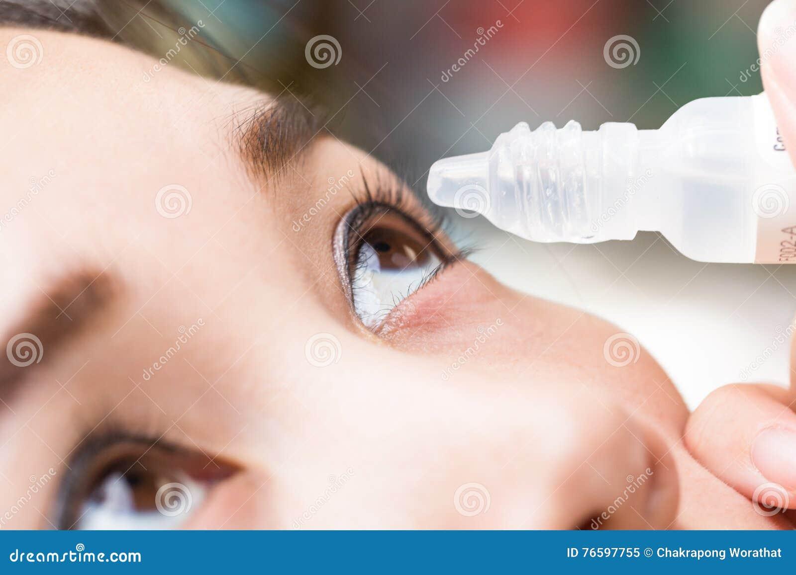 Close up drips into eye cataract medication.
