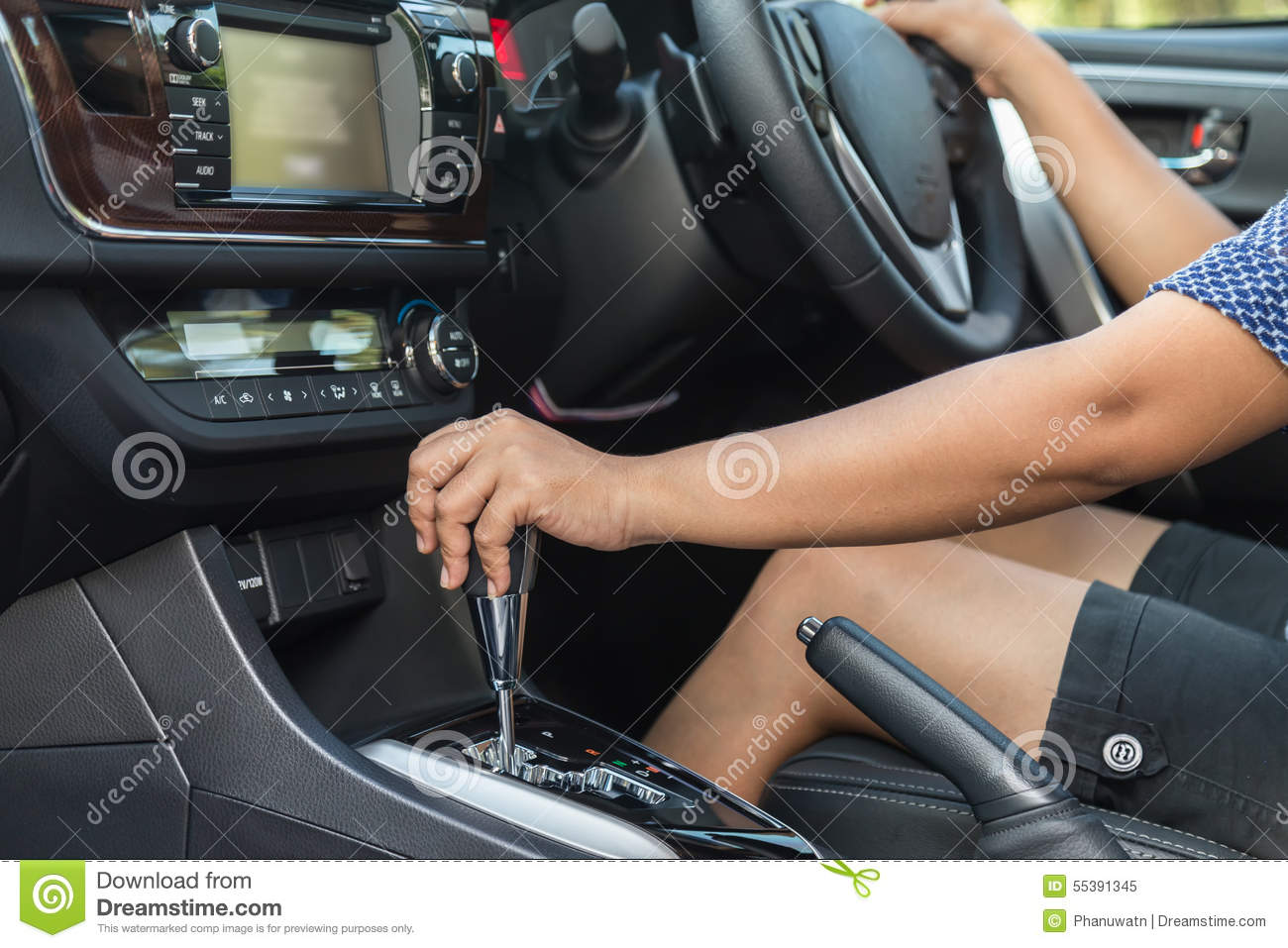 Close up driver left hand shifting the gear stick