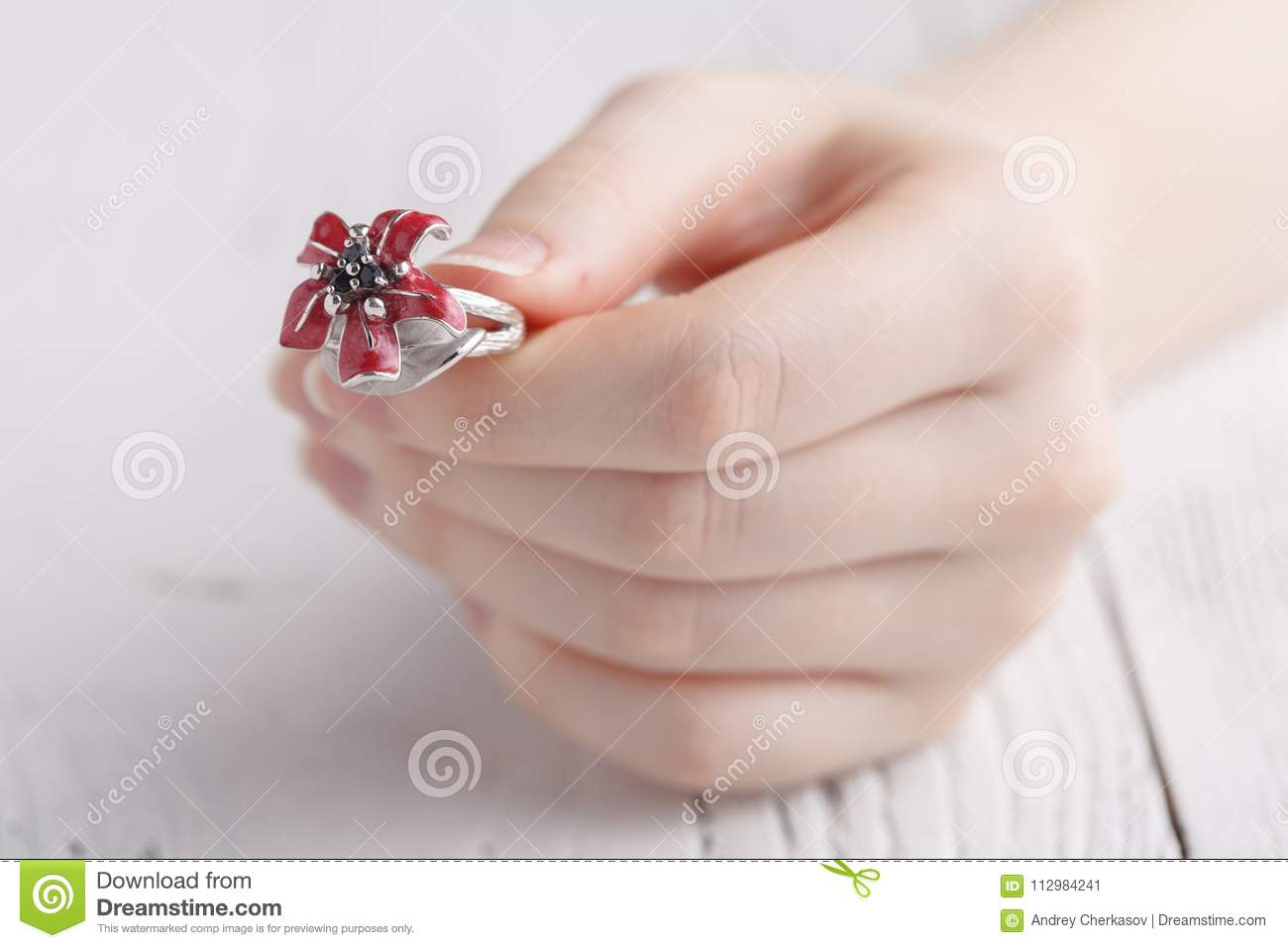 Close up of an elegant ring on the young woman`s finger