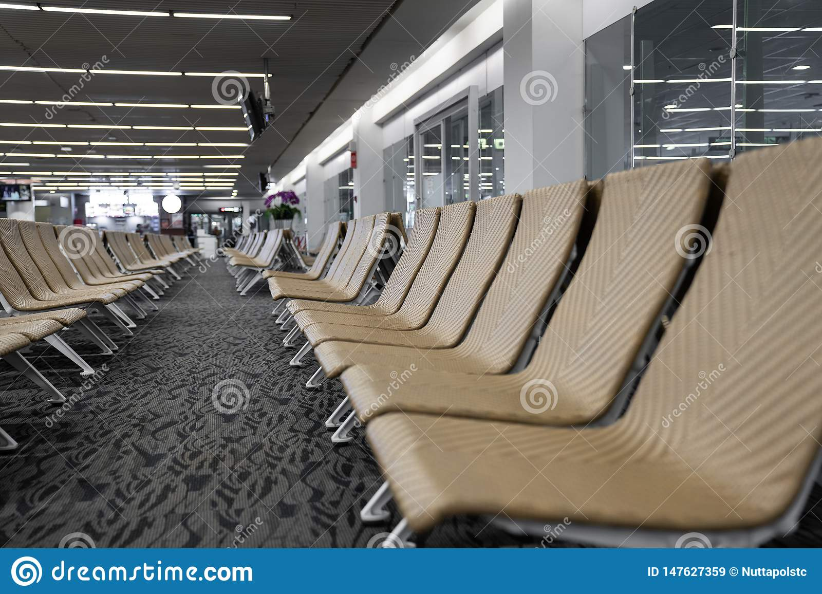 Close up of empty artificial rattan seater in the airport / waiting lounge airport / artificial rattan material / travel passenger