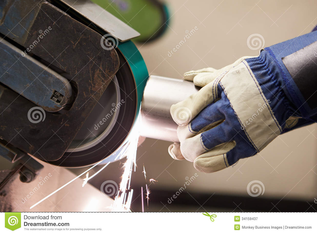 close   engineer  grinding machine  factory stock image image  forties gloves