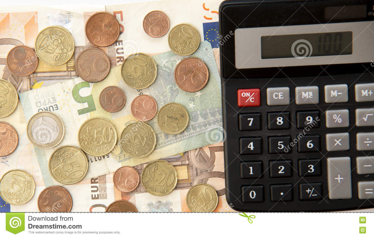 Close up of euro currency. coins, banknotes and calculator