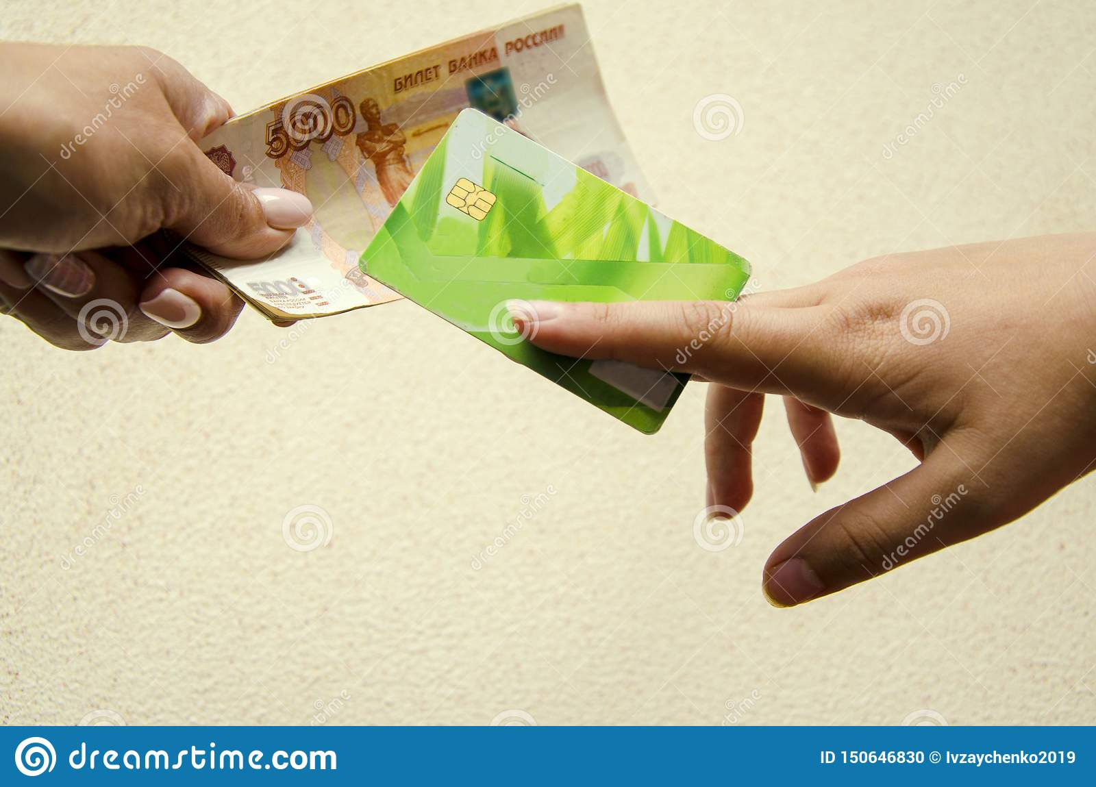Close up of exchanging or transferring a credit card and banknotes to another person. Banking concept