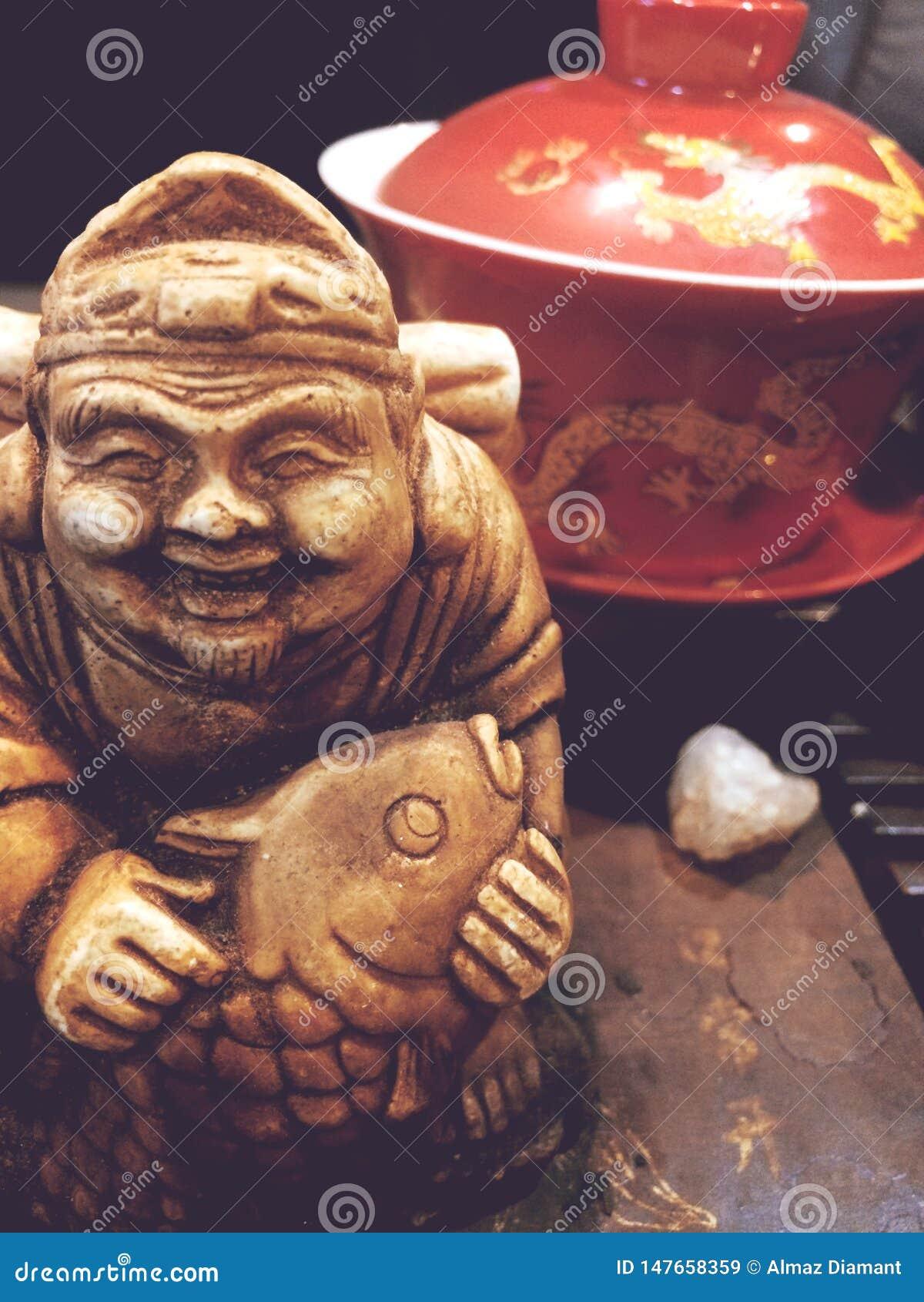 Close up extra, a estátua do deus do chá, a cerimônia de chá,