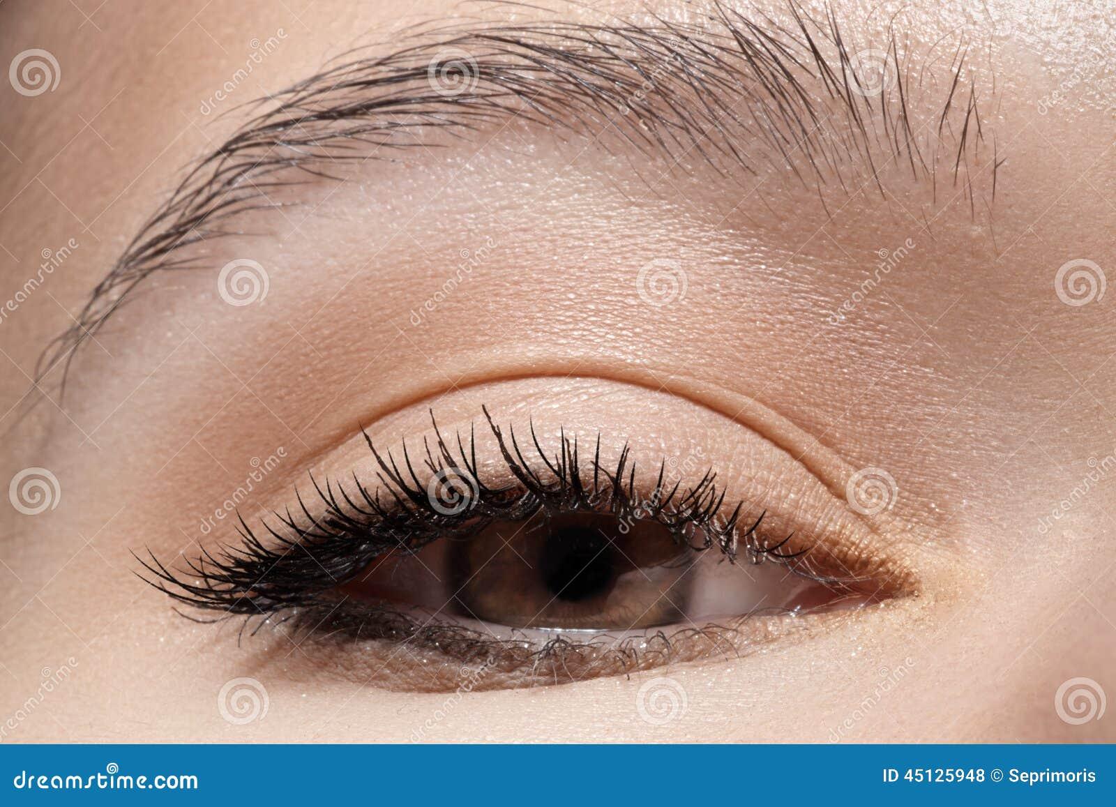 Close-up eye with fashion light make-up, long eyelashes