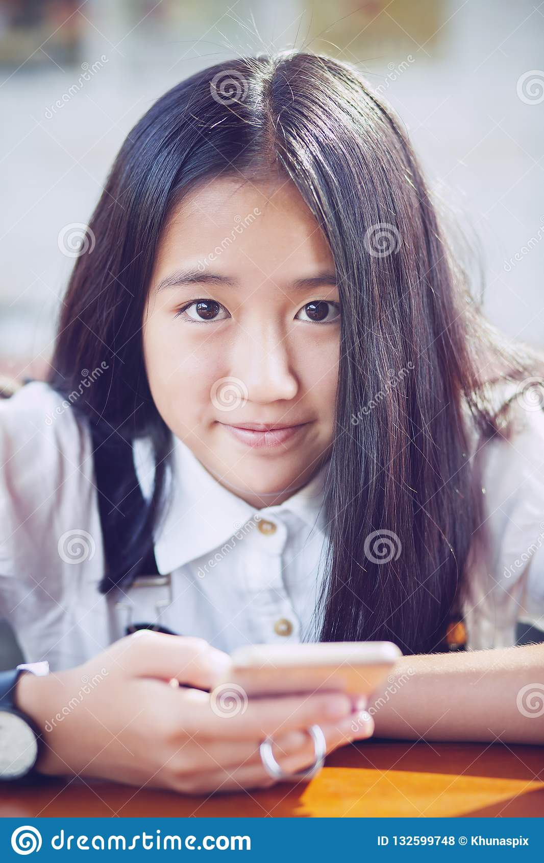 Close up face asian teenager happiness smiling face with smart p