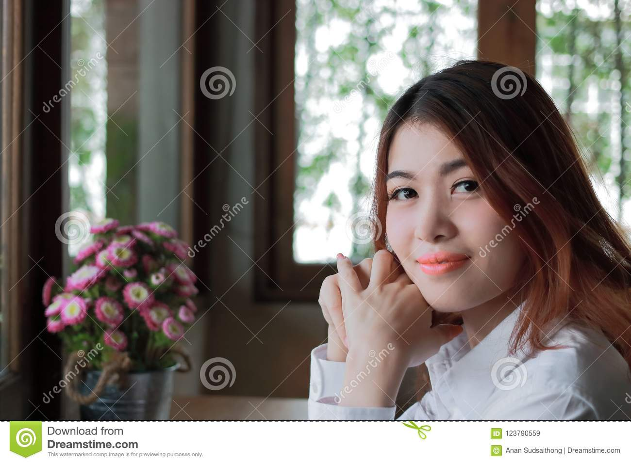 Close up on face of beautiful young Asian woman looking at camera with copy space.