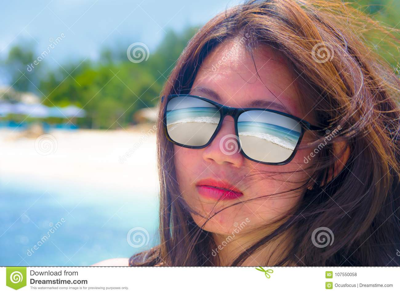 63d3e1662a Close up face portrait of young beautiful Asian woman wearing sunglasses  with tropical beach sea and