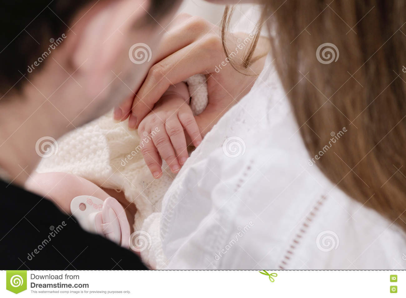 Close Up Family Portrait Of Little Cute Baby Hands In Parent\'s H ...