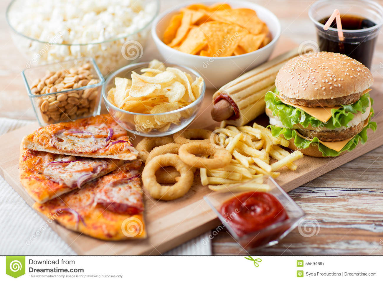 Close up of fast food snacks and drink on table stock for Table snack cuisine