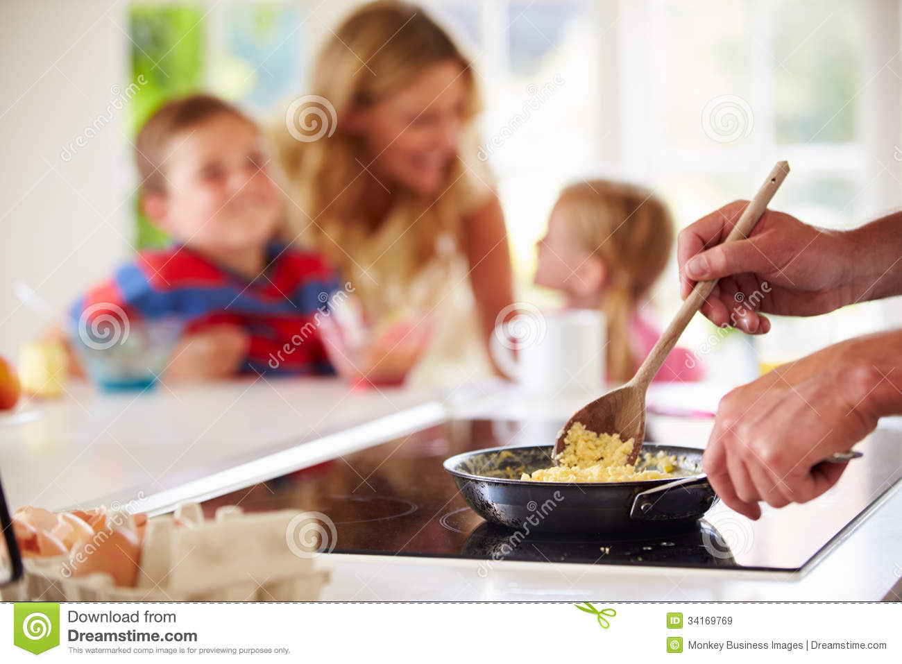 Close Up Of Father Preparing Family Breakfast In Kitchen ...