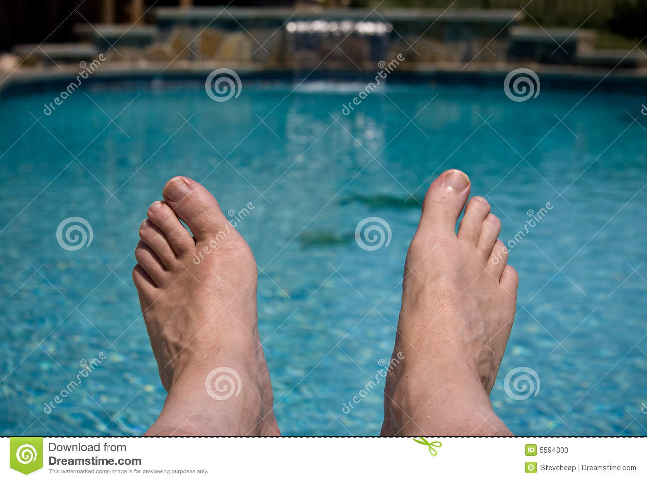 Close up of feet over pool