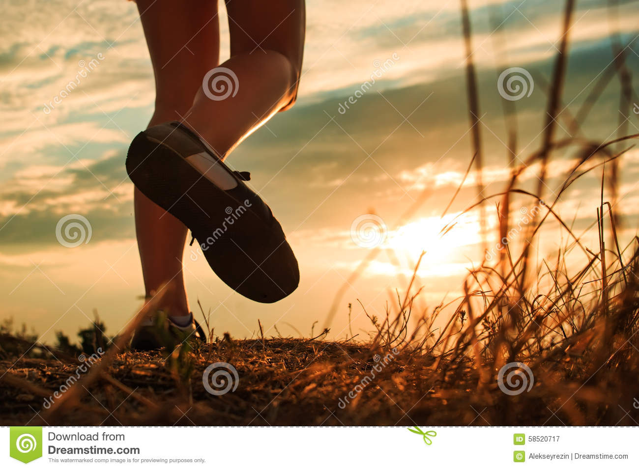 Close up of feet sportwoman in autumn grass