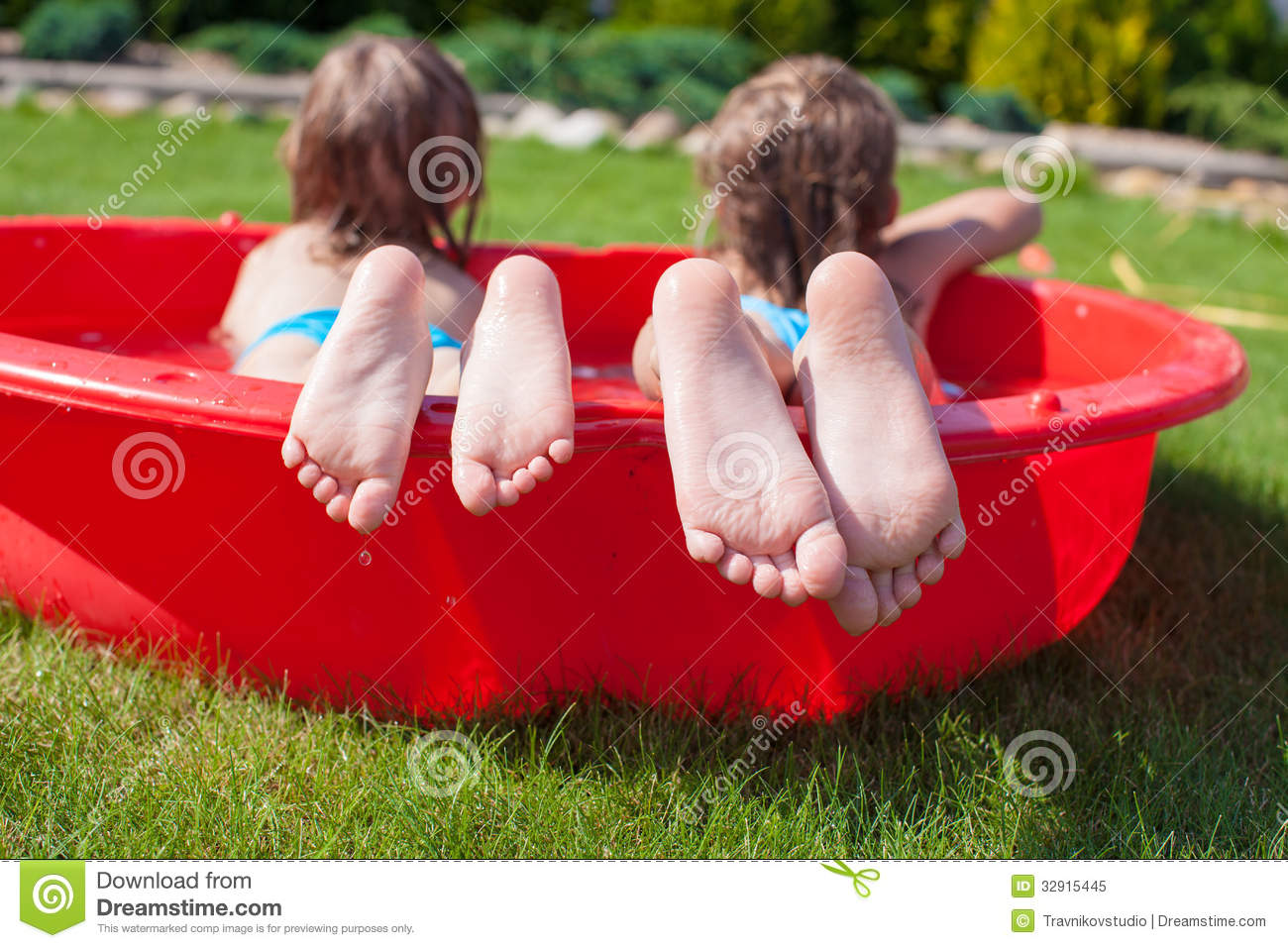 Close-up Of Feet Two Sisters In Small Pool Royalty Free Stock Photo ...