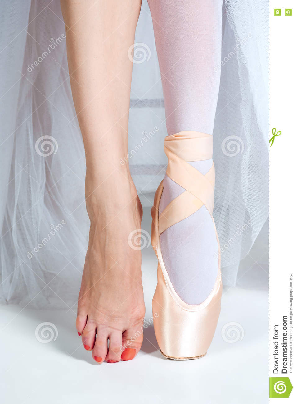 The Close-up Feet Of Young Ballerina In Pointe Shoes Stock ...