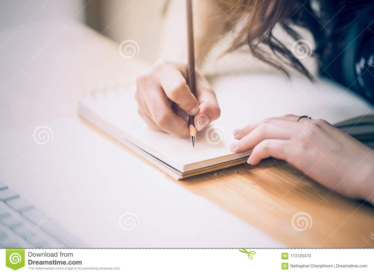 Close up of female designer hands at workplace drawing something