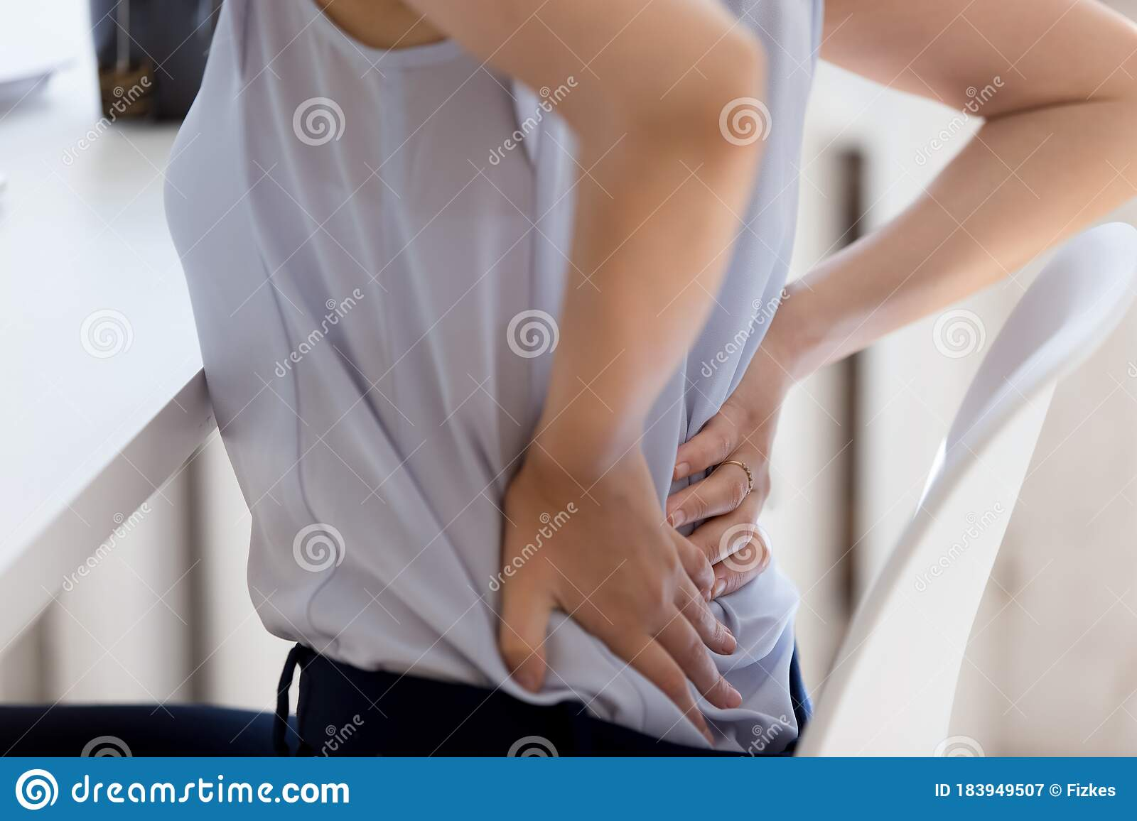Close Up Of Female Employee Suffer From Lower Back Ache Stock Image - Image  of concept, ache: 183949507