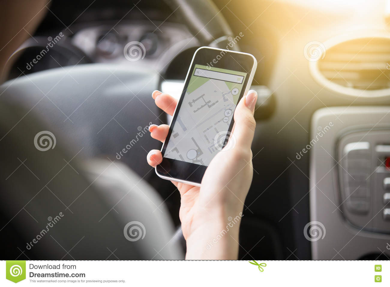 Close-up of female hand holding her phone using navigation syste