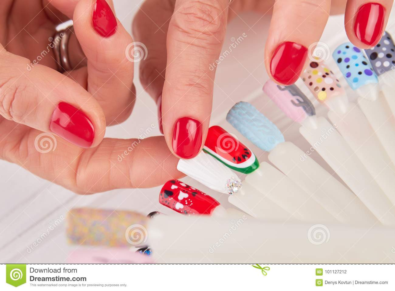 Close Up Of Female Hands And Nail Art Samples. Stock Photo - Image ...