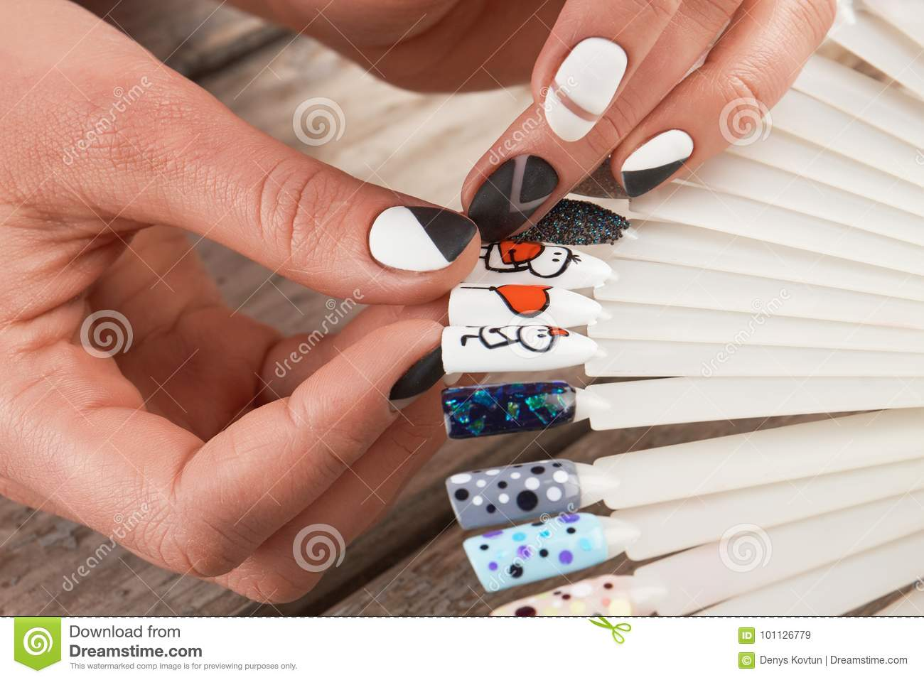 Close Up Of Female Hands And Nail Art Samples. Stock Image - Image ...