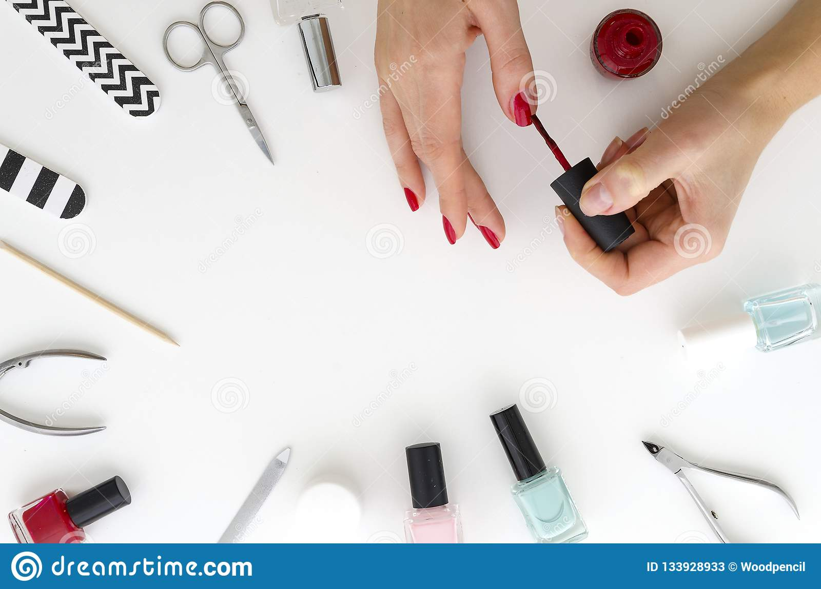 Close Up Of Female Hands Making Manicure With Red Nail Polish.Frame ...