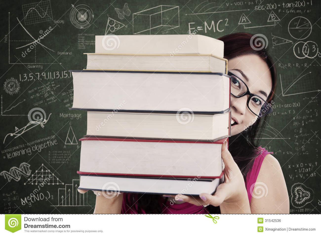 Close-up female student bring stack of books in class