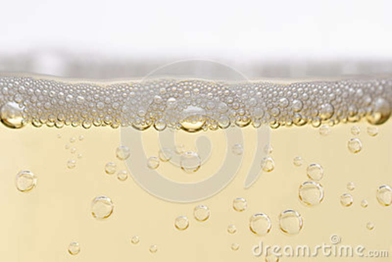 Close Up of Filled Champagne Glass with Rising Bubbles