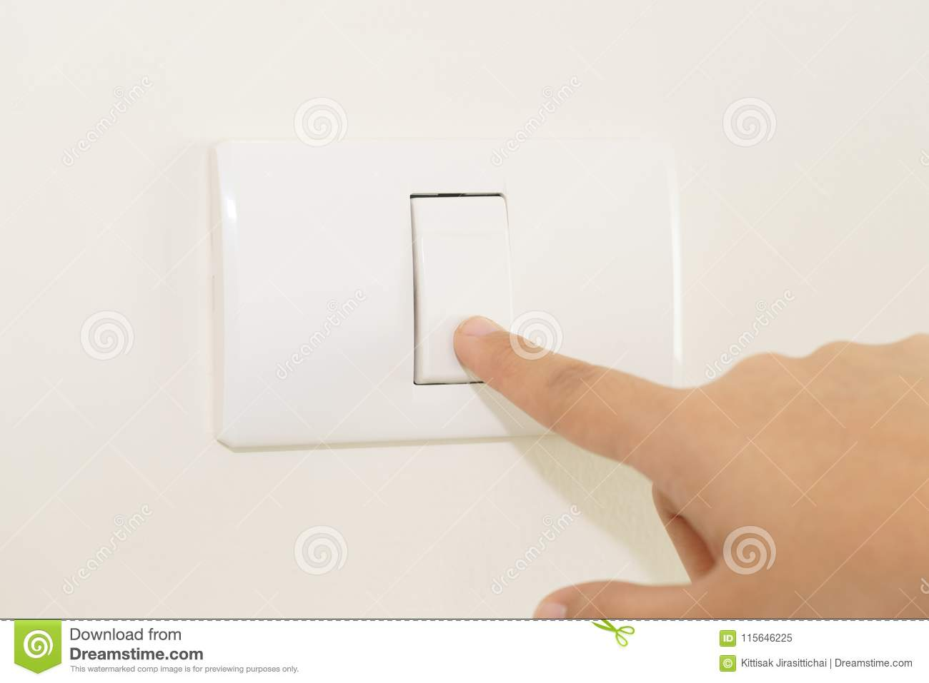 Close Up Of Finger Turning Off On Light Switch On Wall Stock