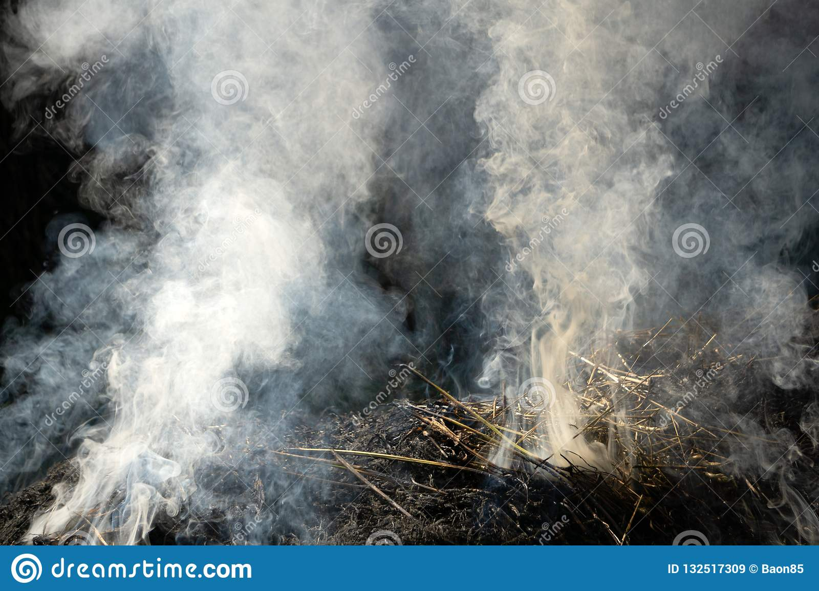 Close up fire burning stack of rice straw almost complete