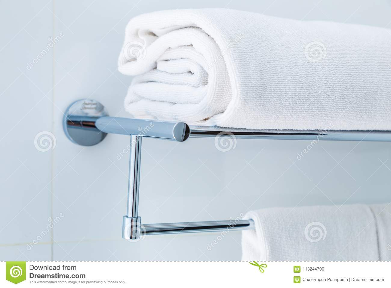 Close Up Of Folded White Bathroom Towels On The Rack In A White ...