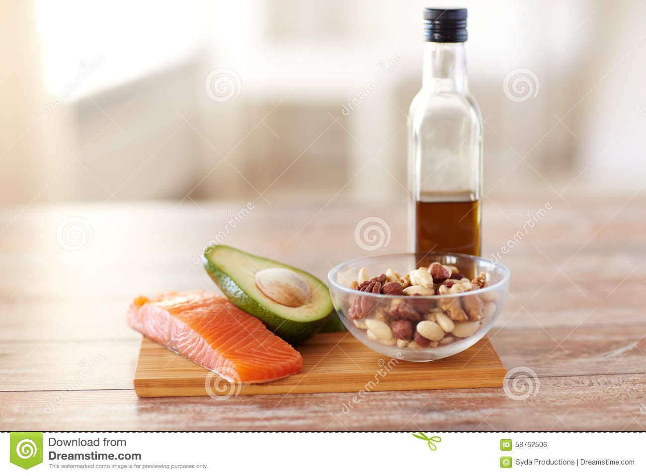 Close up of food and olive oil bottle on table stock photo for Eating table