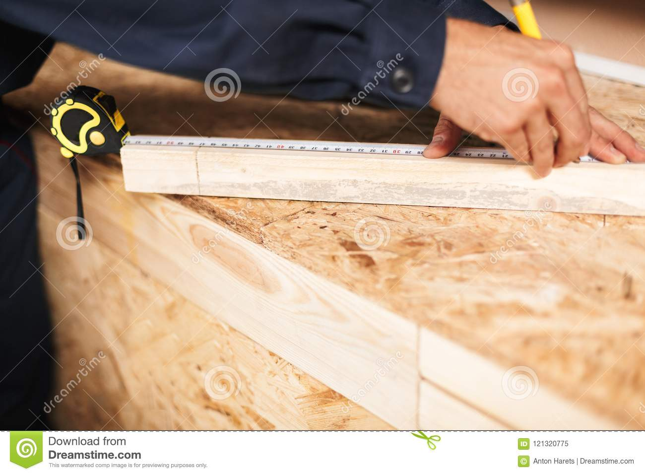 Close Up Foreman Hands Using Measuring Tape And Pencil In ...